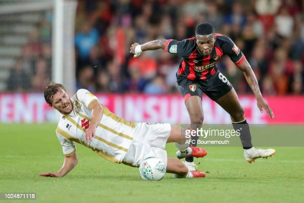 Jefferson Lerma of Bournemouth and Alex Gilbey of Milton Keynes Dons during the Carabao Cup Second Round match between AFC Bournemouth and Milton...