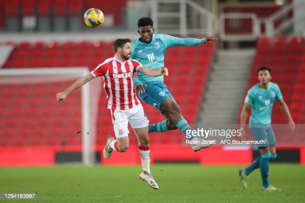 Jefferson Lerma of Bournemouth heads clear from Joe Allen of Stoke City during the Sky Bet Championship match between Stoke City and AFC Bournemouth...