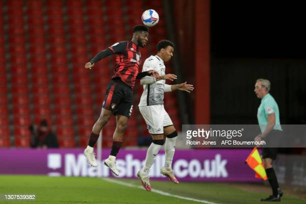 Jefferson Lerma of Bournemouth heads clear from Morgan Whittaker of Swansea City during the Sky Bet Championship match between AFC Bournemouth and...