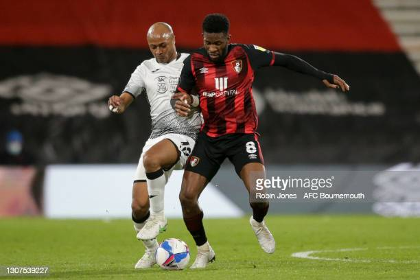 Jefferson Lerma of Bournemouth holds off Andre Ayew of Swansea City during the Sky Bet Championship match between AFC Bournemouth and Swansea City at...