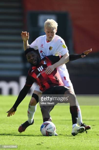 Jefferson Lerma of Bournemouth is challenged by Will Hughes of Watford during the Sky Bet Championship match between AFC Bournemouth and Watford at...