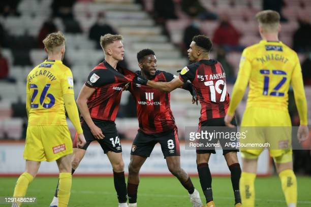 Jefferson Lerma of Bournemouth steps in between Sam Surridge and Junior Stanislas after frustration got the better of them during the Sky Bet...