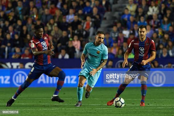 Jefferson Lerma of Levante UD and Paco Alcacer of FC Barcelona during the La Liga match between Levante and FC Barcelona at Ciutat de Valencia...