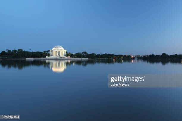 jefferson memorial among trees seen across water, washington, d. c., usa - jefferson memorial stock pictures, royalty-free photos & images