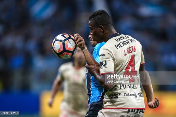 Jefferson Mena of Ecuador's Barcelona vies for the ball with Pedro Geromel of Brazil's Gremio during their Copa Libertadores 2017 football match held...