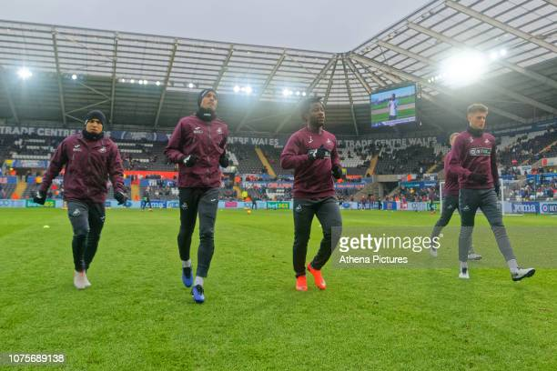 Jefferson Montero Kyle Naughton Wilfried Bony and Joe Rodon of Swansea City warm up prior to the game during the Sky Bet Championship match between...