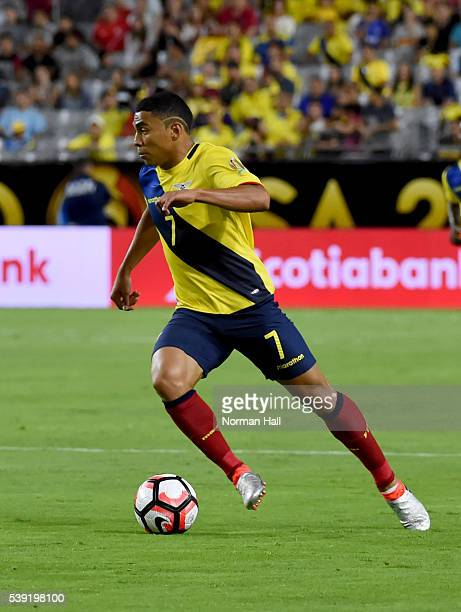 Jefferson Montero of Ecuador brings the ball up field during a group B match between Ecuador and Peru at University of Phoenix Stadium as part of...