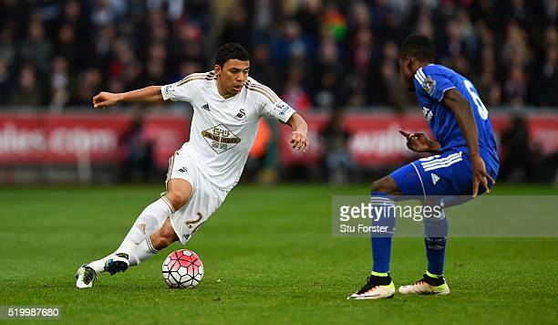 Jefferson Montero of Swansea City and Baba Rahman of Chelsea compete for the ball during the Barclays Premier League match between Swansea City and...