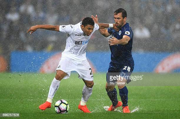 Jefferson Montero of Swansea City and Christian Fuchs of Leicester City battle for possession during the Premier League match between Leicester City...
