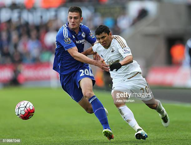 Jefferson Montero of Swansea City and Matt Miazga of Chelsea compete for the ball during the Barclays Premier League match between Swansea City and...