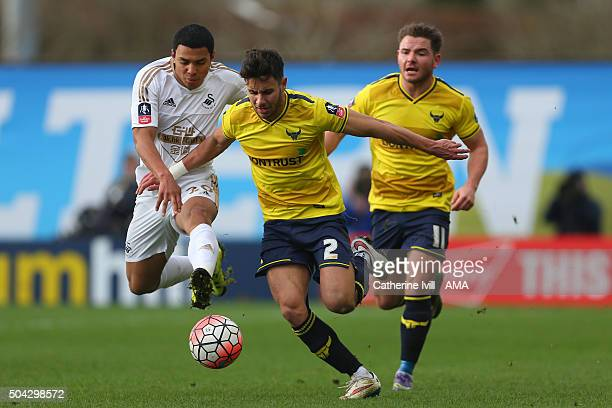 Jefferson Montero of Swansea City battles with George Baldock and Alex MacDonald of Oxford United during The Emirates FA Cup match between Oxford...