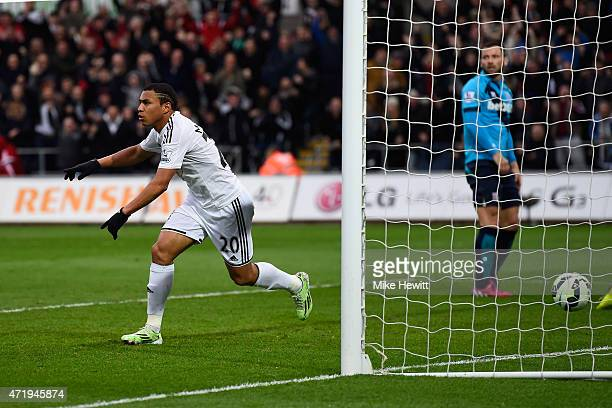 Jefferson Montero of Swansea City celebrates scoring his team's first goal during the Barclays Premier League match between Swansea City and Stoke...