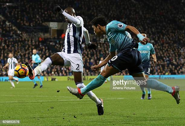 Jefferson Montero of Swansea City FC looks for a way past Allan Nyom of West Bromwich Albion during the Premier League match between West Bromwich...