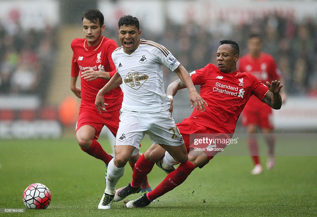 Jefferson Montero of Swansea City is challenged by Nathaniel Clyne of Liverpool during the Barclays Premier League match between Swansea City and Liverpool at The Liberty Stadium on May 1, 2016 in Swansea, Wales.