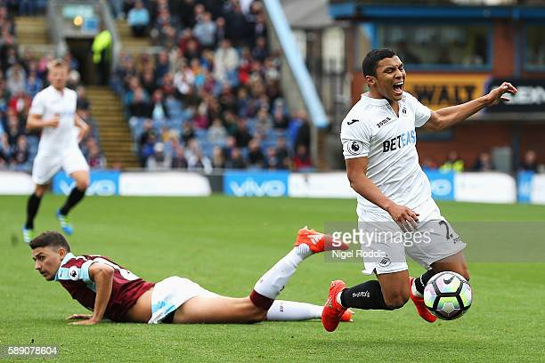 Jefferson Montero of Swansea City is fouled by Michael Keane of Burnley of Burnley during the Premier League match between Burnley and Swansea City...