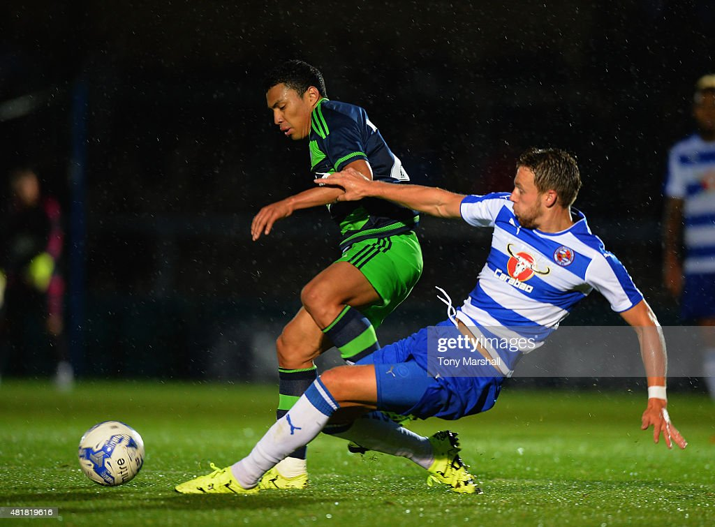 Jefferson Montero of Swansea City is tackled by Chris Gunter of Reading during the Pre Season Friendly match between Reading and Swansea City at Adams Park on July 24, 2015 in High Wycombe, England.