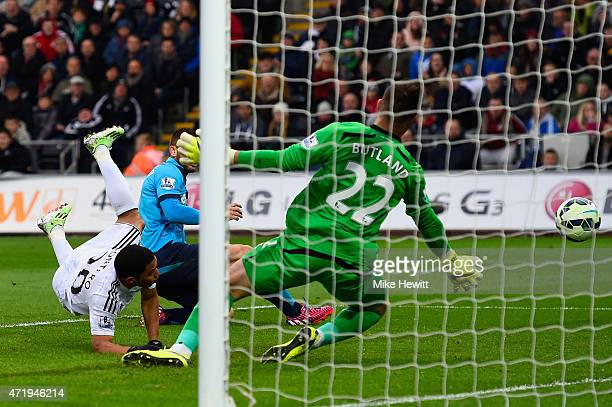 Jefferson Montero of Swansea City scores his team's first goal past Jack Butland of Stoke City during the Barclays Premier League match between...