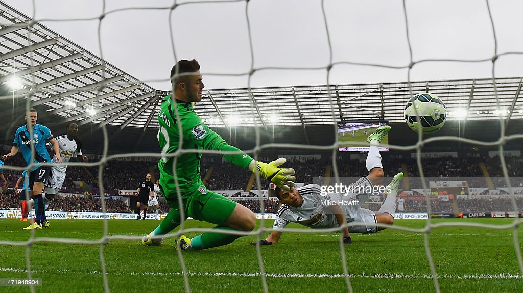 Jefferson Montero of Swansea City scores his team's first goal past Jack Butland of Stoke City during the Barclays Premier League match between Swansea City and Stoke City at Liberty Stadium on May 2, 2015 in Swansea, Wales.