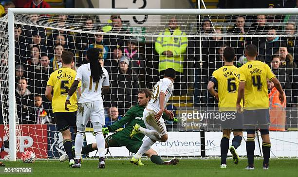 Jefferson Montero of Swansea City scores the opening goal past Sam Slocombe of Oxford United during The Emirates FA Cup third round match between...