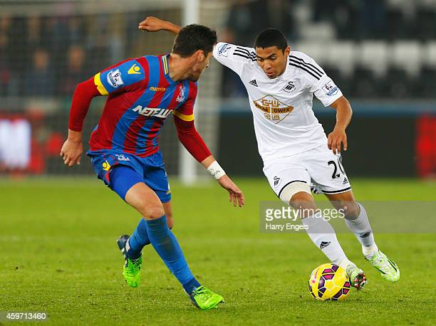 Jefferson Montero of Swansea City takes on Joel Ward of Crystal Palace during the Barclays Premier League match between Swansea City and Crystal...