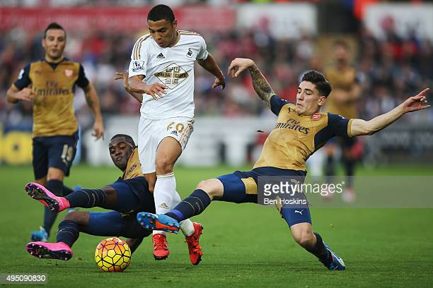 Jefferson Montero of Swansea City vies for the ball with Joel Campbell and Hector Bellerin of Arsenal during the Barclays Premier League match...