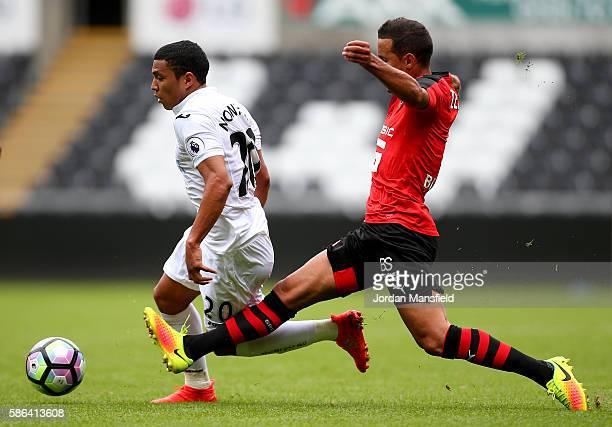 Jefferson Montero of Swansea takes the ball past Mehdi Zeffane of Stade Rennais during the preseason friendly between Swansea City and Stade Rennais...