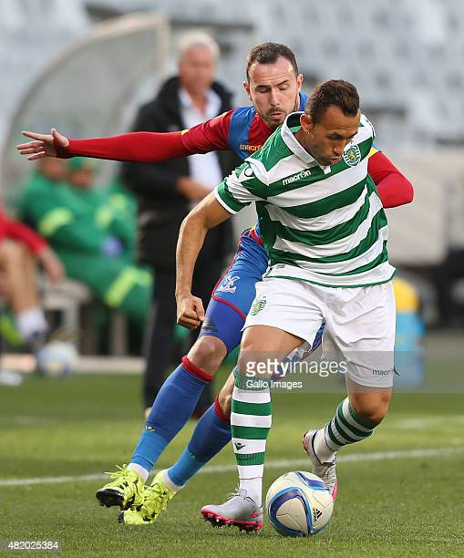 Jefferson Nascimento of Sporting Club de Portugal competes with Jordon Mutch of Crystal Palace during the 2015 Cape Town Cup Final match between...