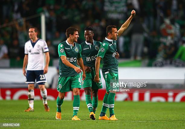 Jefferson of Sporting Lisbon celebrates scoring their second goal with team mates during the UEFA Champions League Group G match between Sporting...