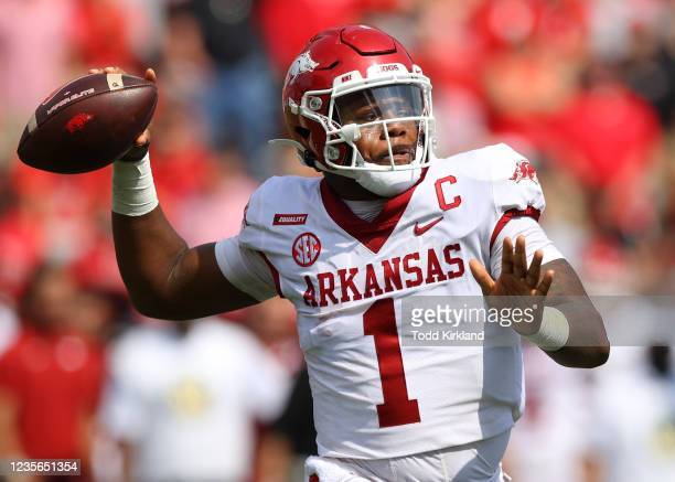 Jefferson of the Arkansas Razorbacks rolls out to pass in the first half against the Georgia Bulldogs at Sanford Stadium on October 2, 2021 in...