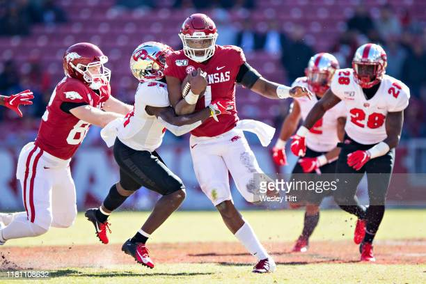 Jefferson of the Arkansas Razorbacks runs the ball in the second half and is tackled by Antwon Kincade of the Western Kentucky Hilltoppers at...