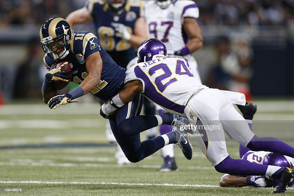 A.J. Jefferson #24 of the Minnesota Vikings tackles Brandon Gibson #11 of the St. Louis Rams during the game at Edward Jones Dome on December 16, 2012 in St. Louis, Missouri. The Vikings won 36-22.