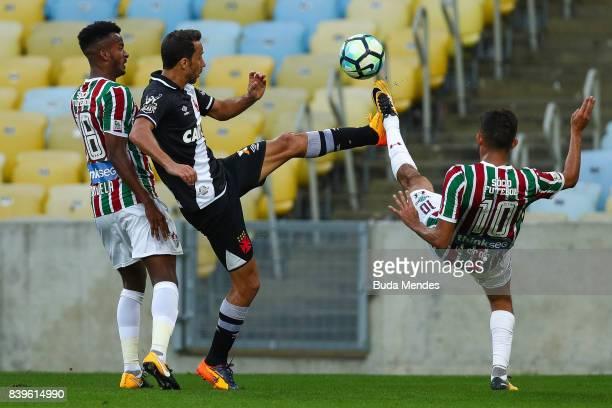 Jefferson Orejuela and Gustavo Scarpa of Fluminense struggle for the ball with Nene of Vasco da Gama during a match between Fluminense and Vasco da...