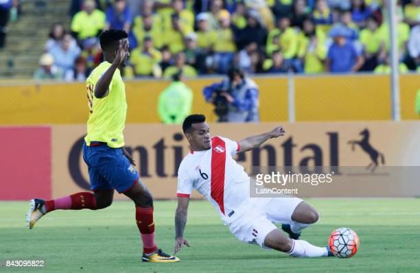 Jefferson Orejuela of Ecuador runs as Miguel Trauco of Peru slides for the ball during a match between Ecuador and Peru as part of FIFA 2018 World...