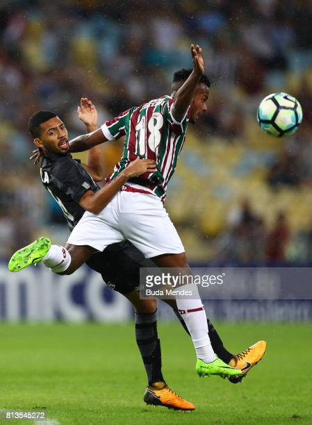Jefferson Orejuela of Fluminense struggles for the ball with Matheus Fernandes of Botafogo during a match between Fluminense and Botafogo as part of...