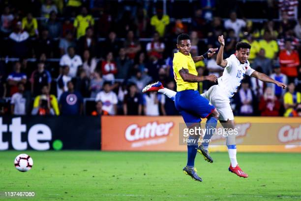 Jefferson Orejuela of United States and Antonio Valencia of Ecuador fight for the ball in the second half at Orlando City Stadium on March 21, 2019...