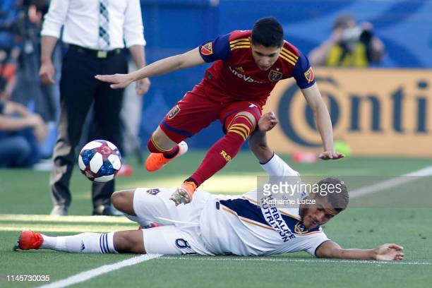 Jefferson Savarino of Real Salt Lake and Jonathan dos Santos of Los Angeles Galaxy fight for control of the ball during a game at Dignity Health...