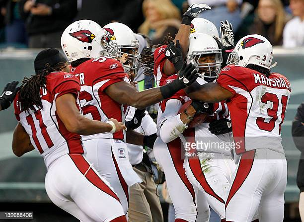 Jefferson, second from right, of the Arizona Cardinals is congratulated by teammates Larry Fitzgerald, Reggie Walker and Richard Marshall after...