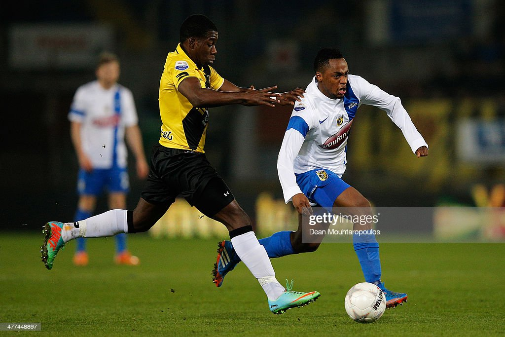 Jeffery Sarpong of NAC and Renato Ibarra of Vitesse battle for the ball during the Eredivisie match between NAC Breda and Vitesse at the Rat Verlegh Stadion on March 8, 2014 in Breda, Netherlands.