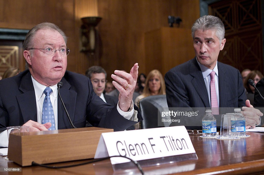 Jeffery Smisek, chairman, president and chief executive officer of Continental Airlines Inc., right, listens to Glenn Tilton, chairman, president and chief executive officer of United Airlines, during an Antitrust, Competition Policy and Consumer Rights Subcommittee hearing on the proposed merger between United Airlines and Continental Airlines Inc.in Washington, D.C., U.S., on Thursday, May 27, 2010. United Airlines' proposed merger with Continental Airlines won't cut competition because discount carriers can begin service and win passengers, the chief executives of the two companies told a Senate antitrust panel. Photographer: Andrew Harrer/Bloomberg via Getty Images