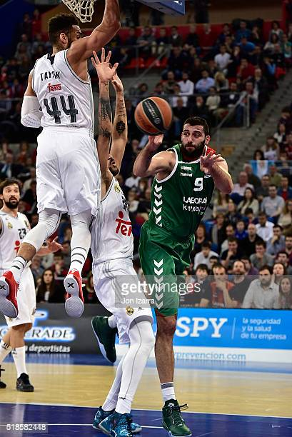 Jeffery Taylor #44 of Real Madrid competes with Gustavo Ayon #14 of Real Madrid and Ioannis Bourousis #9 of Laboral Kutxa Vitoria Gasteiz in action...