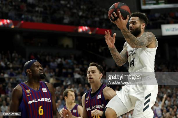 Jeffery Taylor of Real Madrid in action against Chris Singleton of Barcelona Lassa during the Liga Endesa week 24 match between Real Madrid and FC...