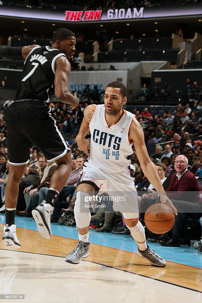 Jeffery Taylor #44 of the Charlotte Bobcats drives against Joe Johnson #7 of the Brooklyn Nets at the Time Warner Cable Arena on March 6, 2013 in Charlotte, North Carolina.