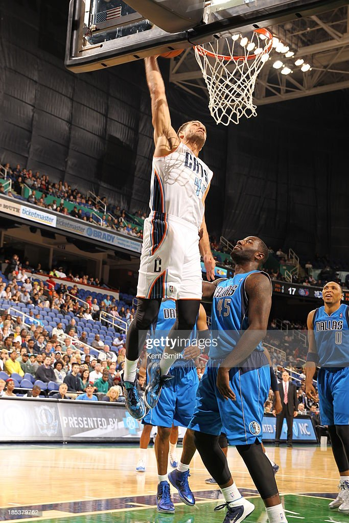 Jeffery Taylor #44 of the Charlotte Bobcats dunks against DeJuan Blair #45 of the Dallas Mavericks at the Greensboro Coliseum on October 19, 2013 in Greensboro, North Carolina.