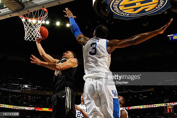 Jeffery Taylor of the Vanderbilt Commodores shoots against Terrence Jones of the Kentucky Wildcats in the second half during the championship game of...