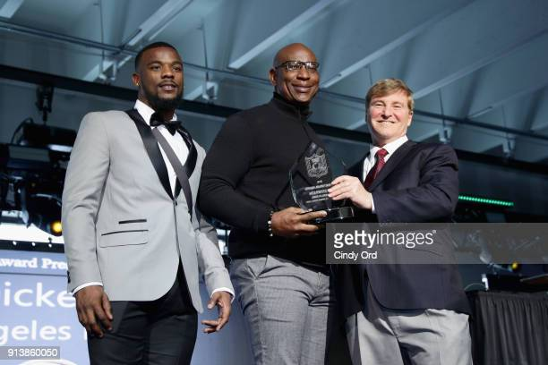 Jeffery Wilson, Eric Dickerson and Leigh Steinberg pose onstage during Leigh Steinberg Super Bowl Party 2018 on February 3, 2018 in Minneapolis,...