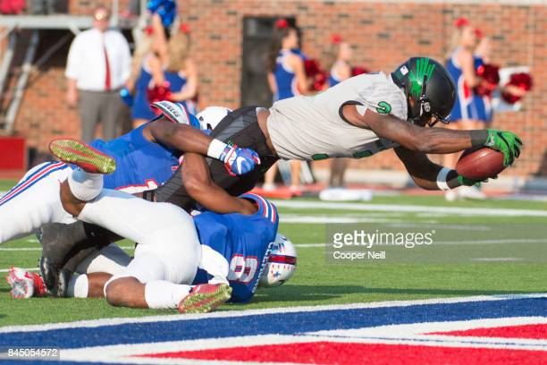 Jeffery Wilson of the North Texas Mean Green dives into the end zone for a touchdown against the SMU Mustangs during the first half at Gerald J Ford...