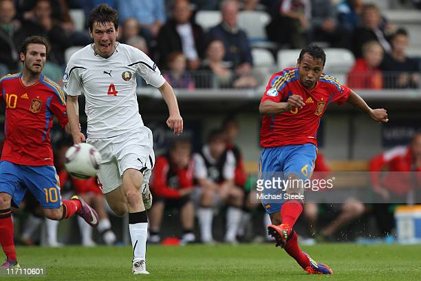 Jeffren Suarez of Spain scores the third goal as Sergei Politevich closes in during the UEFA European Under21 Championship semifinal match between...