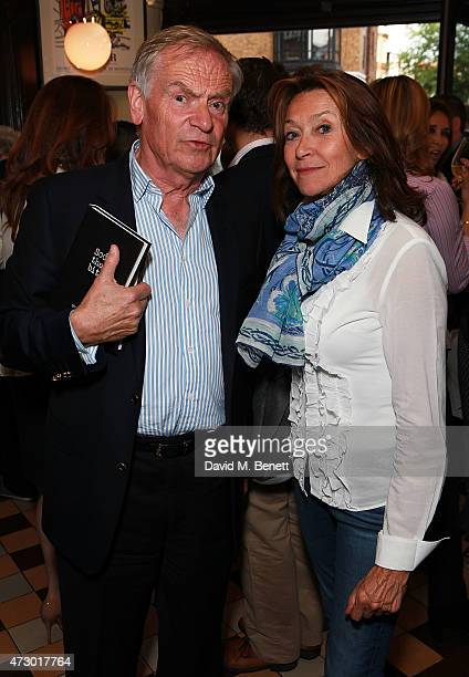 Jeffrey Archer and Cherie Lunghi attend the launch of 'Sod The Bitches' by Steven Berkoff at La Brasserie on May 11 2015 in London England