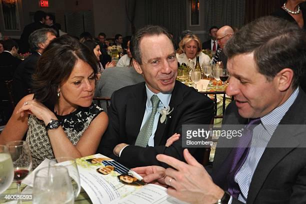 Jeffrey Aronson cofounder and managing principal of Centerbridge Partners LP center his wife Shari Aronson left and Rob Harteveldt global cohead of...