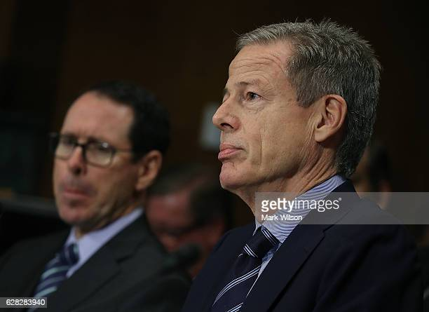 Jeffrey Bewkes CEO of Time Warner and Randall Stephenson CEO of ATT listen to testimony during a Senate Judiciary Subcommittee hearing on Capitol...